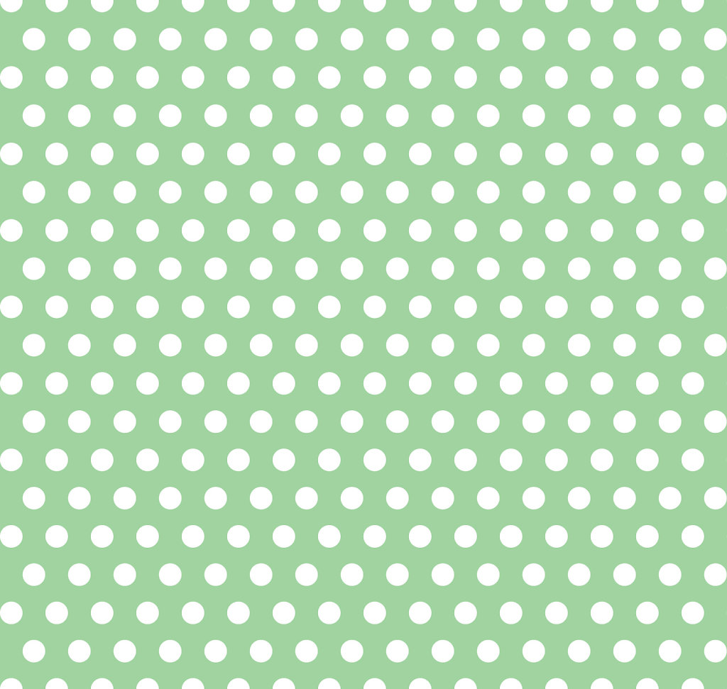 Pale green background with white polka dots in foreground
