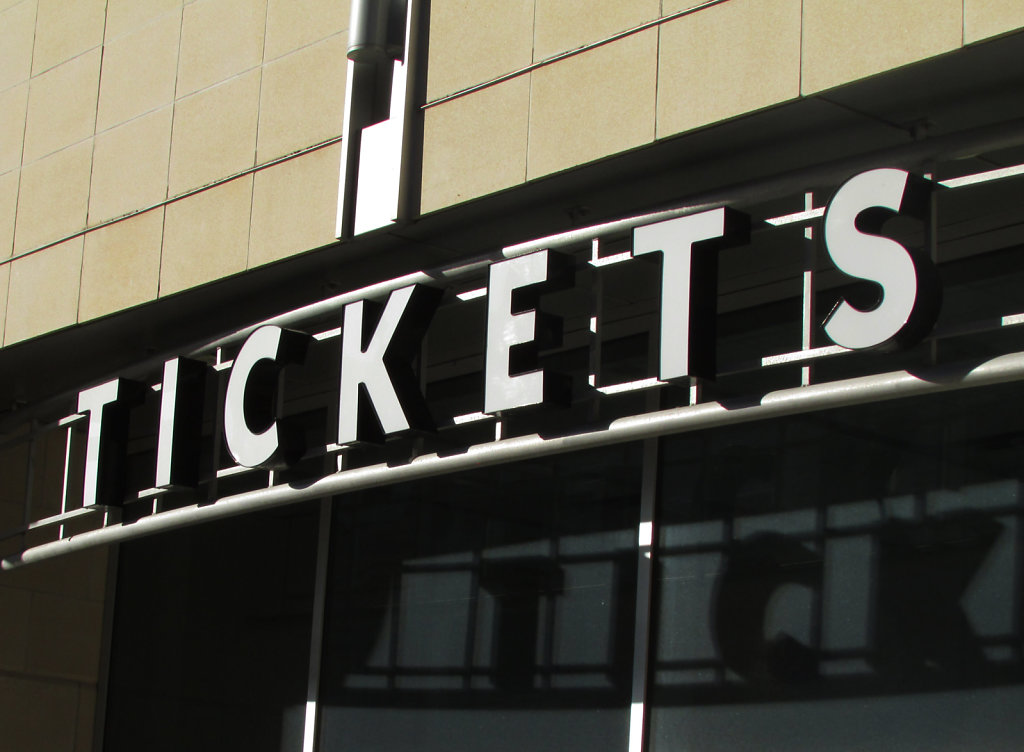 Tickets for sale building sign