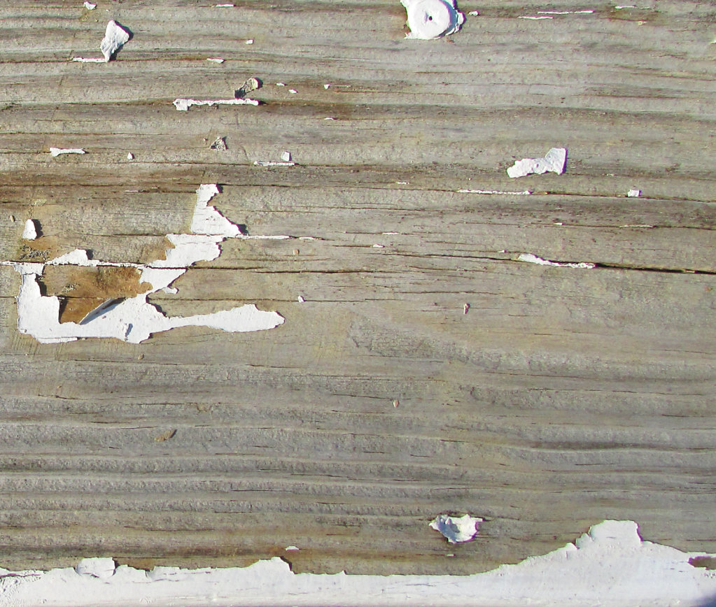 Wood with peeling white paint