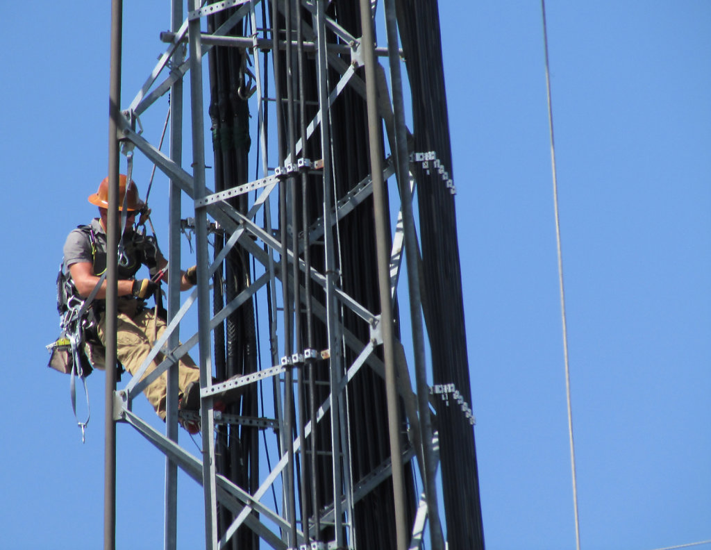 cell phone tower repair worker