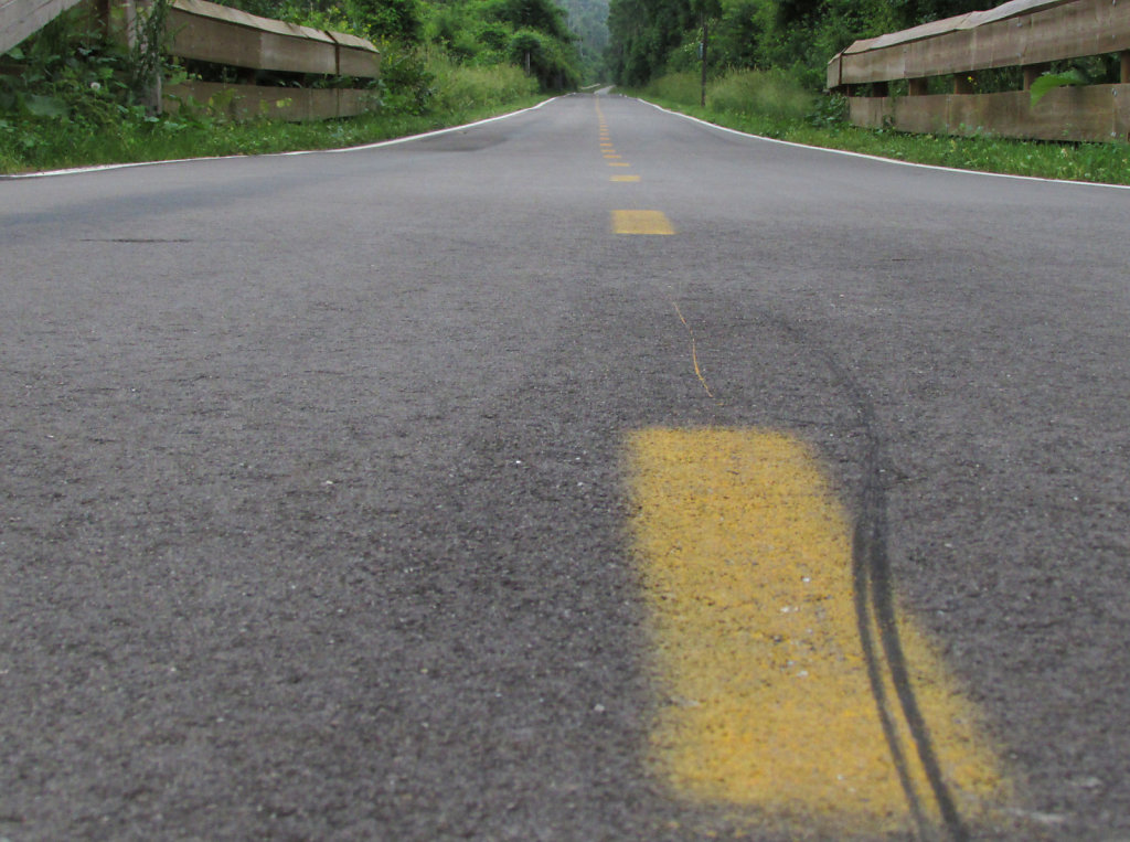 asphalt with center yellow stripes