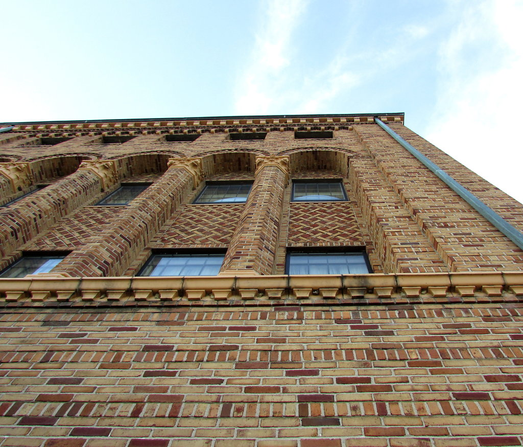 View looking up a brick building