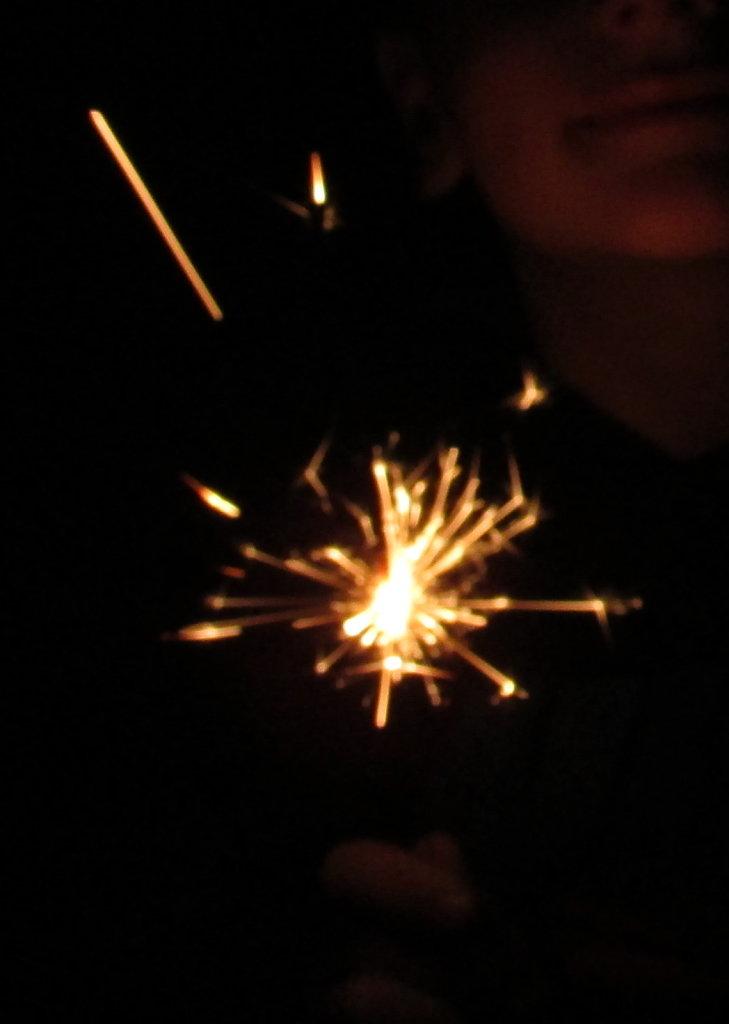 Kid holding a sparkler pic